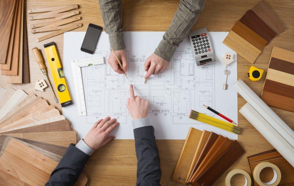 Blueprint of house on table