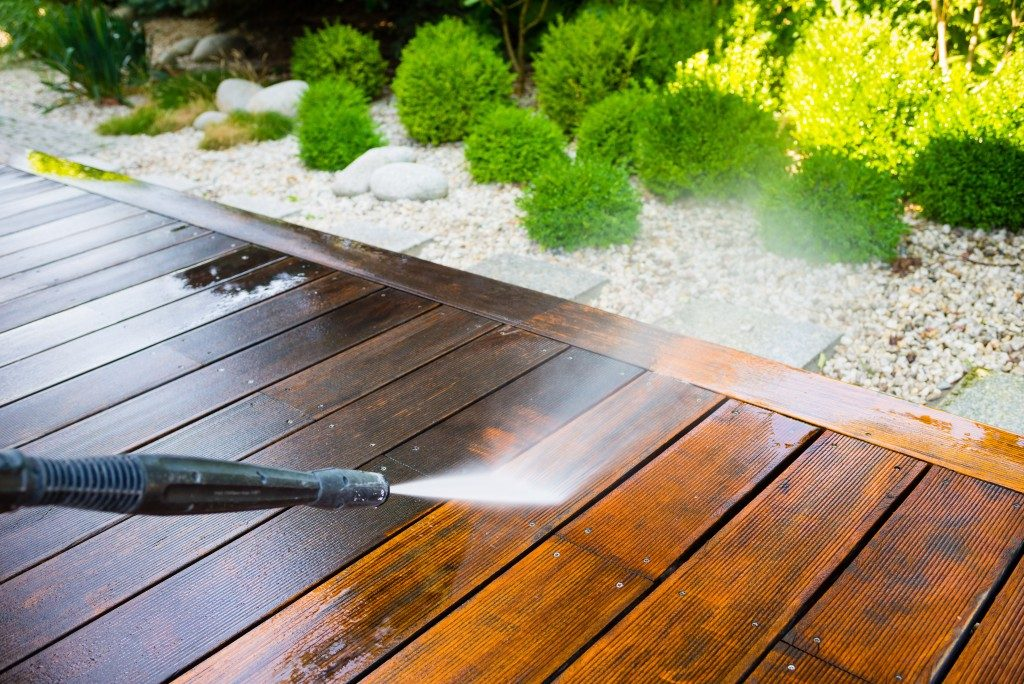 Hose cleaning wooden deck