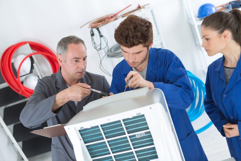 Technicians installing a unit