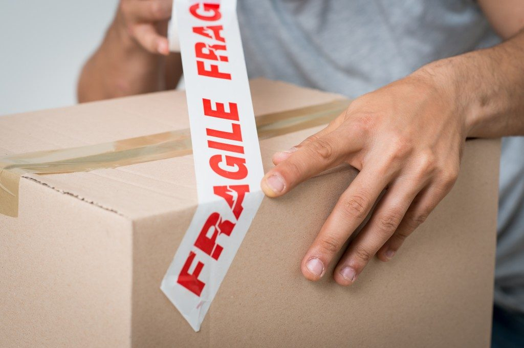 Labeling boxes with Fragile tape