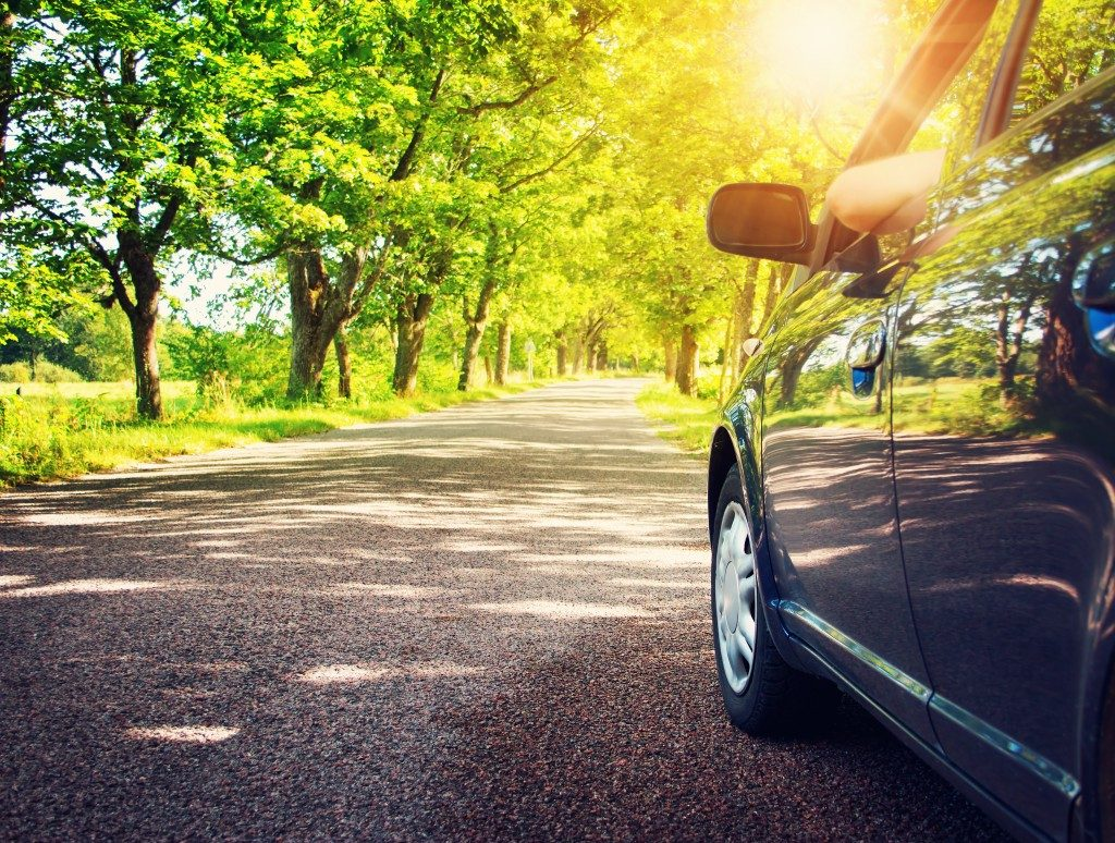 car driving along an asphalt road