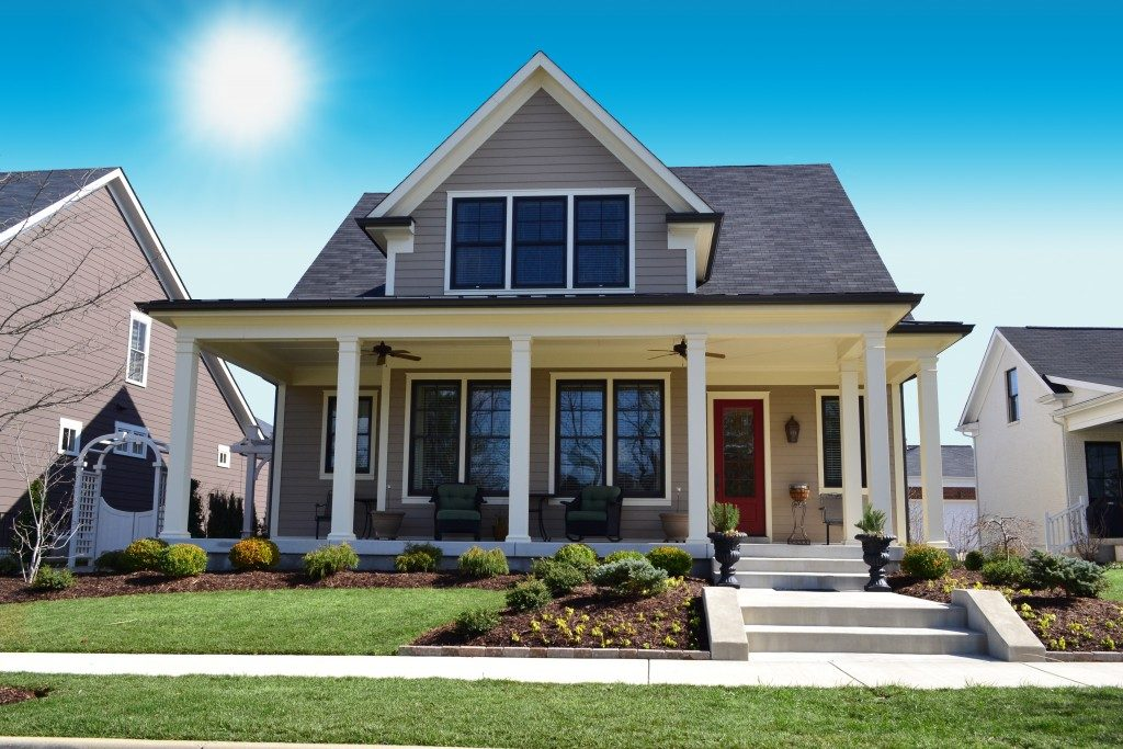 Beige New England Style Suburban Home