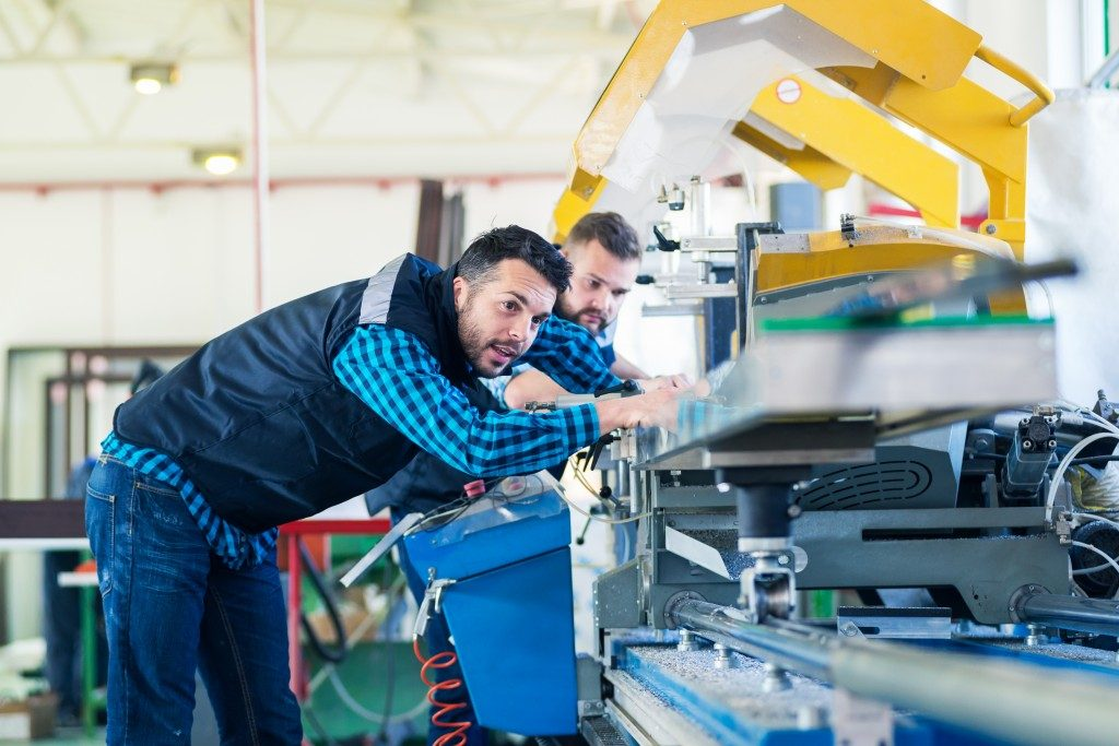 manufacturing workplace with two workers