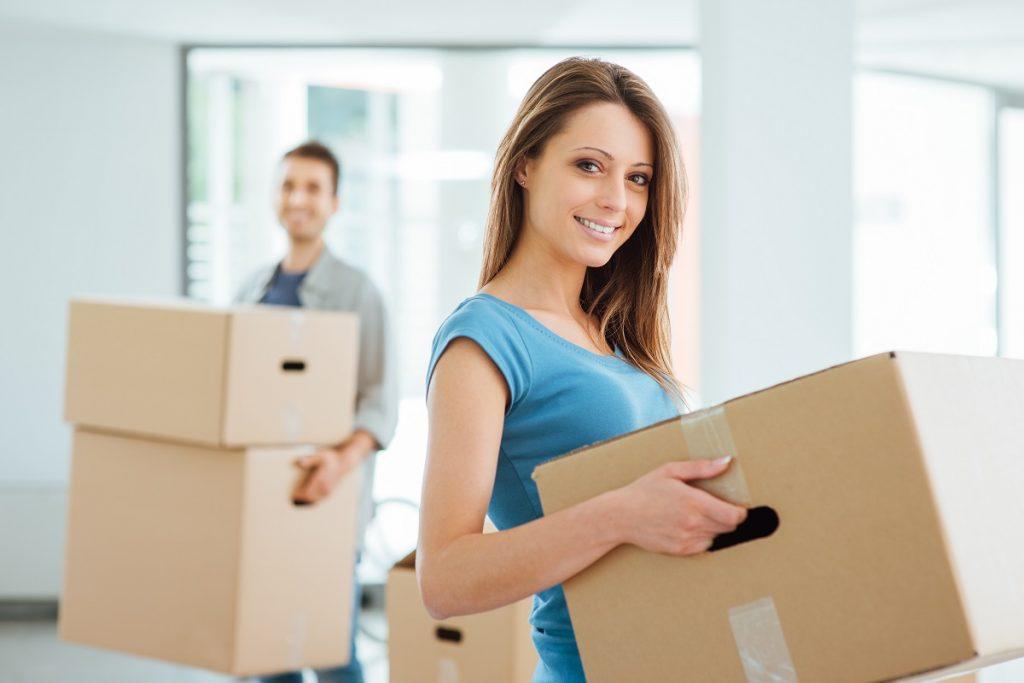 couple carrying carton boxes