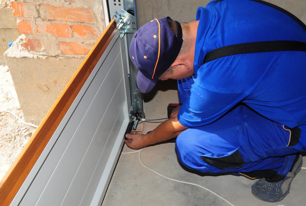 man changing garage door